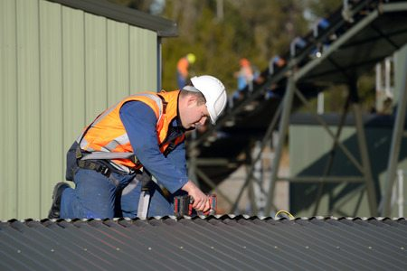 commercial roofer inspecting roof