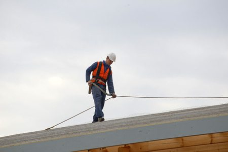 roofer walking and inspecting roof