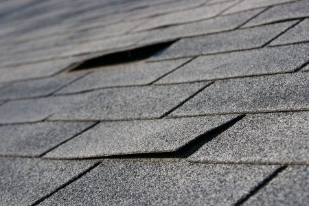roofing trouble - damage to shingles that needs repair